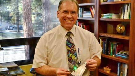 Professor Brent Edstrom holding Arduino